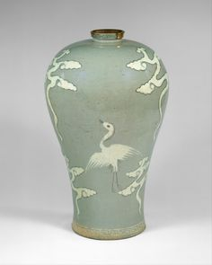 Maebyeong with decoration of cranes and clouds, Goryeo dynasty (918–1392), late 13th century. Korea. Stoneware with inlaid design under celadon glaze; H. 11 1/2 in. (29.2 cm); Diam. 7 1/8 in. (18.1 cm); Diam. of base 4 3/8 in. (11.1 cm). The Metropolitan Museum of Art, New York, Fletcher Fund, 1927 (27.119.11) © 2000–2015 The Metropolitan Museum of Art.