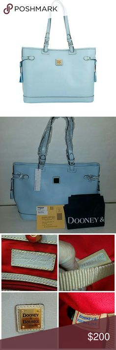 "Dooney & Bourke Saffiano Leather Double Strap Tass Dooney & Bourke Saffiano Leather Double Strap Tassel Bag...brand new with tag color pale blue.  brand new. Comes with tag. And dust bag. Measures approximately 14-1/4""W x 10""H x 5-1/2""D with a 10"" strap drop; weighs approximately 1 lb, 8 oz Body/trim 100% leather; lining 100% cotton Dooney & Bourke Bags Shoulder Bags"