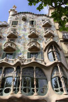 Casa Batlló, Barcelona Antoni Gaudí brought his exuberant take on Art Nouveau to Barcelona, creating many of the city's architectural landmarks. Casa Batlló, situated on the Passeig de Gràcia, is one of his best-known works and features allusions to the legend of St. George and the Dragon. Its exterior is sheathed in colorful pieces of broken ceramics, while the roof is covered in scalelike tiles.