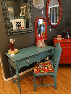 Ornate turquoise desk paired with fun bright red fabric. Modern Vintage