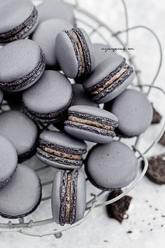 Oreo Macarons?? The American Oreo meets the infamous French macaron? O M G !!! I think this is the most incredibly unique idea for a cookie ever!! Bond appetite -or- should I say....E N J O Y !