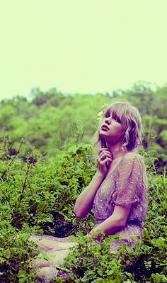 Is it just me, or does it look like she's scratching her neck because she has poison ivy or something?