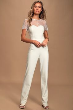 We are completely smitten by the Lulus Take My Heart White Lace Short Sleeve Jumpsuit! Floral lace jumpsuit with a sheer decolletage and straight-cut pants. White Short Jumpsuit, White Pantsuit, Strapless Jumpsuit, Lace Jumpsuit, Jumpsuit With Sleeves, Skinny Fit Jeans, Carolina Herrera, Ted Baker, Bachelorette Outfits