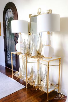 elegant christmas entry table  #entryway #porch #frontporch #christmasdecor #goldchristmasdecor #ohholynight #christmasdecorations #whitechristmasdecor #outdoorchristmasdecor #outsidechristmasdecor  #entry #entrytable #mercuryglass #whitechristmas #christmastree #wreath #goldornaments #outdoorchristmasdecorations  #outsidechristmasdecorations #christmaslights #foyer #frontgate #gate