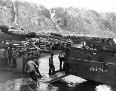 US soldiers unloading supplies, Attu. 13 May 1943.