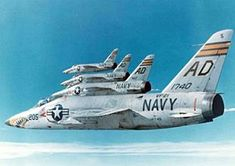 """F11f grumman tiger. Introduced in 1956. First supersonic carrier based fighter jet for the Navy. Also flown by the Blue Angeles (1957-1968).The F11f had a short career. It was inferior to the F-8 Crusader and the j65 engine was unreliable. This group is fighter Squadron VF-21 """"Freelancers"""" from the USS Ranger."""