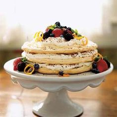 Grand Marnier Meringue Torte This grown-up birthday cake blends delicately crisp meringues, orange-scented cream, a hint of chocolate, and fresh fruit. The vitamin C–packed berries add a bit of tartness and pick up on the subtle orange flavors. Healthy Desserts, Just Desserts, Delicious Desserts, Dessert Recipes, Fruit Dessert, Healthy Recipes, Croissants, Fresh Strawberry Recipes, Fresh Fruit