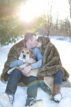 Winter engagement photo ideas with dog. Snow photography session. See more here: http://www.emoorephotography.com/blog-kelsey-tim-engagement/