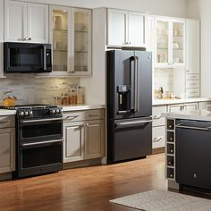 These on-trend appliance finishes help express your style, shake up the look of your kitchen and make an update feel fresh. Kitchen Cabinets With Black Appliances, Slate Appliances, Stainless Steel Kitchen Appliances, Black Kitchens, Home Kitchens, Ikea Kitchens, Kitchen Remodel Cost, Kitchen Redo, Kitchen Design