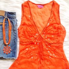 BCBG sequined top BCBGirls top in bright orange! So fun and summery, looks great with white or blue denim. Translucent orange sequins over most of the front, which is defined by a thin velvet ribbon. This ribbon also becomes a tie in the back. Deep V-neck and sheer, requires a camisole underneath, double layer of the material below the empire waist. I only wore this once, excellent condition, no damage. 100% viscose BCBG Tops