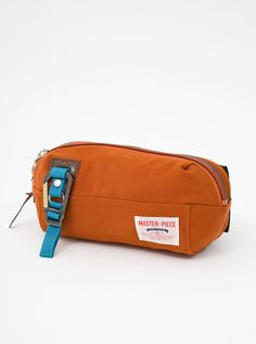 Master-Piece Link Waist Bag Orange Premium Leather Trims Nylon Twill Shell Water-Resistant & Durable Single Zip Pocket at Interior Carabiner Clasp Zip Main Compartment Made in Japan