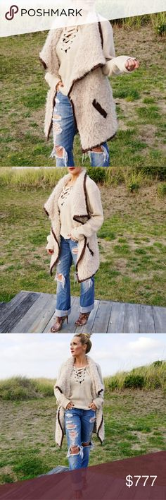 FAUX SHEARLING FUR VEST Brand new Boutique item  Grab this fabulous faux SHEARLING fur vest for your winter wardrobe! Faux fur, faux suede trim details. Longer in front then back. Racer back cut. A must have!  One size fits most . Jackets & Coats Vests