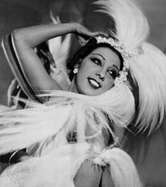 """Cabaret legend Josephine Baker was born on June 3rd in 1906 in St. Louis, Missouri. After emigrating to France, she became the most successful performer in the nightclubs of 1920s Paris. Topless, wearing ostrich plumes and covered in sequins, Baker sometimes danced alongside her diamond-collared pet cheetah. Hear her sing her 1931 hit """"J'Ai Deux Amors"""""""