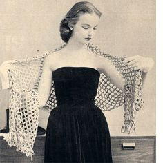 Ribbon Stole Crochet Pattern.   Frankly feminine - a lay ribbon stole that reveals soft, white shoulders. This airy lattice work is new and very chic, worked in crochet, edges with short ribbon loops. The one size shawl measures 22 inches wide by 2-1/2 yards long.