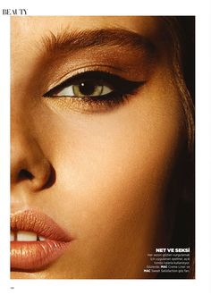 Perfect for fall. Cat-like black swoosh eyeliner with bronzed shadow