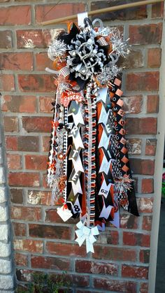 "Orange black white and silver homecoming mum with 24"" streamers. Designed by Crafty bug"