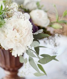 Winter Centerpiece .. I like the greenery in this it feels like Rustic Italian holiday