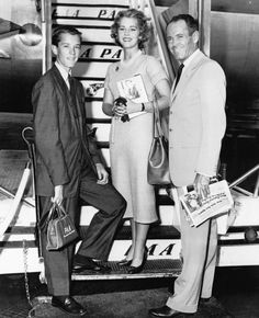 Peter, Jane, and Henry Fonda board a Boeing Stratocruiser.