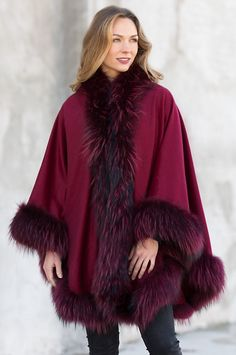 Surround yourself in the luxury of soft Canadian cashmere. The Keira rises to every occasion with elegance, bordered by beautiful raccoon fur.