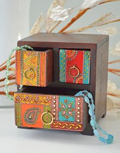 Made from sustainable mango wood this wooden box is hand painted in India. Painted Wooden Boxes, Painted Chairs, Hand Painted Furniture, Wooden Chest, Diy Wood Box, Wood Boxes, Furniture Makeover, Diy Furniture, Woodworking Box