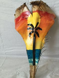 sunset palm tree on palm frond Palm Tree Crafts, Palm Tree Art, Palm Tree Leaves, Palm Trees Beach, Palm Frond Art, Palm Fronds, Coconut Fish, Coconut Leaves, Tiki Faces