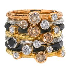 Assorted White Cognac Black Diamond Gold Steel Stacking Rings | See more rare vintage Fashion Rings at https://www.1stdibs.com/jewelry/rings/fashion-rings