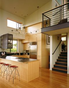 Love the modern railings on the stair landing