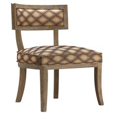 Pairing a midcentury-inspired silhouette with bold geometric-print upholstery, this chic wood side chair brims with eye-catching appeal from Joss and Main