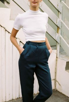 Cropped white top, black high waist trousers