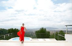 An extravagant landscape and an amazing red chiffon dress with metal yoke and cuffs by Diane Von Frustenberg.  Beautiful black-and-white leather wedge sandals by Bally. #Fashion #Travel #model