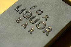 Fox Liquor Bar by Joshua Gajownik, via Behance  - beautiful inline type in gold foil on @Neenah Paper Pewter, Classic Classic Crest.