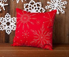 Introducing the first free pattern in our 12 Weeks of Christmas Series. Download the Snowflake Embroidered Pillow Pattern for FREE at connectingthreads.com