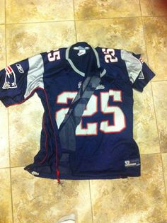 This is how upset Patriots fans are. A guy ripped his jersey off at the game and threw it. My mom caught it.