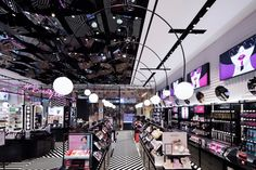 Sugarcup cosmetic store by Betwin Space Design is a study in bold patterns and bolder neon touches.
