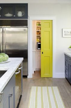 Painting your pantry door a bold color is a great way to add playfulness to your kitchen without going overboard. The yellow door in this traditional kitchen designed by Bronwyn Huffard is a fun twist to an otherwise neutral space. via COCOCOZY