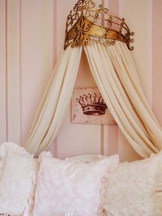 RMS user ajerde transformed this bedroom into an elegant yet shabby chic retreat. A charming daybed boasts an eye-catching gold bed crown with cream-colored fabric, a striking complement to striped pink walls.