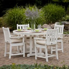 The POLYWOOD® Traditional Garden Outdoor Dining Set adds elegance to your outdoor garden area without stealing the spotlight! The Traditional Garden Collection harmoniously blends with any outdoor landscaping and offers virtually maintenance free care as Outdoor Tables And Chairs, Garden Table And Chairs, Patio Dining Chairs, Outdoor Dining Set, Outdoor Decor, Outdoor Living, Outdoor Spaces, Arm Chairs, Dining Table