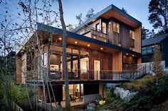 The Madison Park House in Seattle, Washington, is the latest custom-spec house to be designed and built by First Lamp.  cedar wood siding modern hillside slope