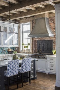Kitchen Decor A cast iron decorative piece livens up a brick backsplash in this kitchen - Brighten up your kitchen with an eclectic, boho-chic vibe. Glass Front Cabinets, New Kitchen Cabinets, Kitchen Backsplash, Backsplash Ideas, Kitchen Brick Backsplash, Painted Brick Backsplash, Copper Backsplash, Beadboard Backsplash, Mirror Backsplash