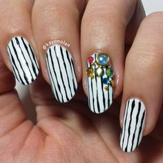 Simple black and white stripes with an assortment of rhinestones and studs~