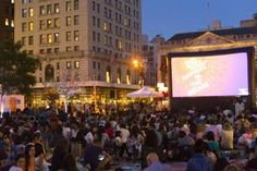 A movie shows on the big screen in Union Square's North Plaza in 2015.