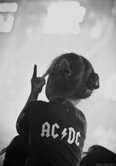 AC DC....awww pic reminds me of my RiRi when she was little like this and loved all my classic rock jams..... the shirt, twin buns and rocker baby hand sign!!! perfect, awww.