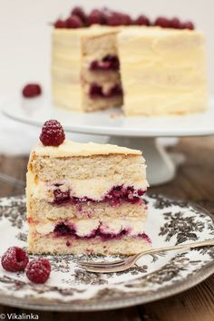 Vanilla sponge cake filled with mascarpone cream and raspberry compote, covered with white chocolate buttercream.