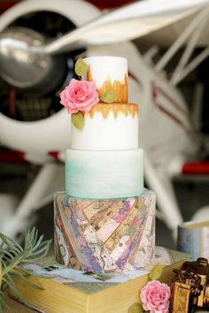 wedding cake with a little bit of a travel theme / http://www.deerpearlflowers.com/travel-themed-wedding-ideas-youll-want-to-steal/2/
