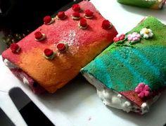 Pionono arco iris relleno de crema chantillí y dulce de leche