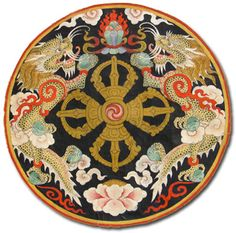 The National Emblem of Bhutan is a circle that projects a double diamond thunderbolt placed above the lotus. There is a jewel on all sides with two dragons on vertical sides. The thunderbolts represent the harmony between secular and religious power while the lotus symbolizes purity. The jewel signifies the sovereign power while the dragons (male and female) stands for the name of the country Druk yul or the Land of the Dragon.