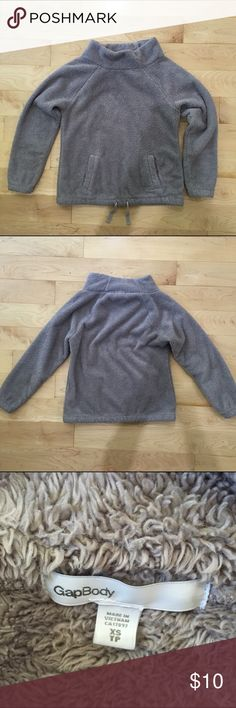 """Fuzzy Gap Body pullover Super duper comfy and cozy Gap Body pullover. Has a wide funnel neck, kangaroo pocket and adjustable waist. Color is a really pretty lavender/grey. Size XS. Great pre-loved condition. Boxy fit and thick material. Measures 19"""" flat across bottom, 19.5"""" pit to pit, 24"""" from neck to bottom, 24.5"""" from shoulder to cuff. GAP Sweaters Cowl & Turtlenecks"""