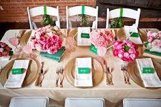 bows and arrows table setting in pink & green.