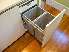 Continuing a focus on clean, uncluttered interiors, storage space and recycling bins are concealed behind custom cabinetry.