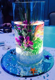 Under the sea centerpiece . LED lit up with seaweed beautiful for weddings , Quince or a sweet 16.
